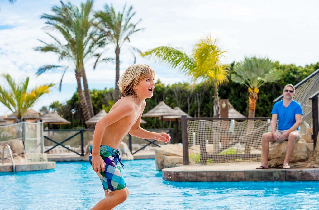 Younger guests having fun at the pool at the Santa Cruz Suites