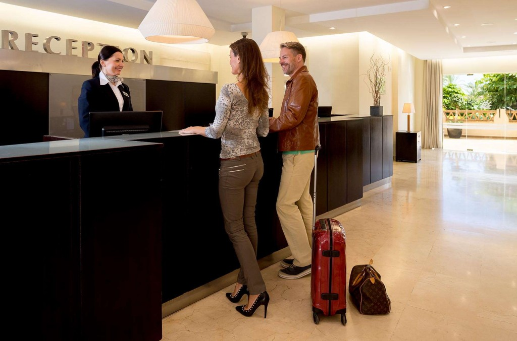 Guests checking into the Santa Cruz Suites