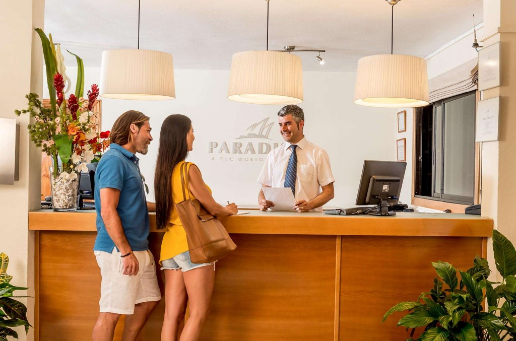 Guests checking into reception in Paradise