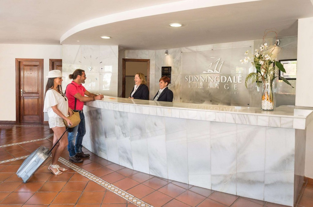 Guests checking into reception at Sunningdale Village