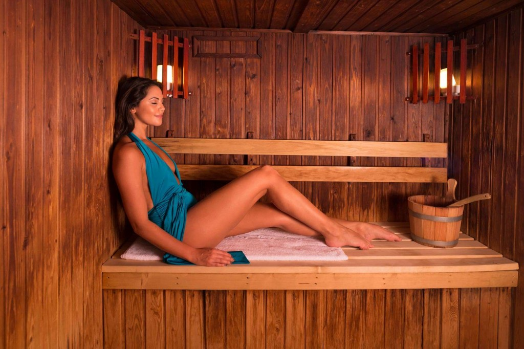 Guest enjoying the modern sauna at Trenython Manor
