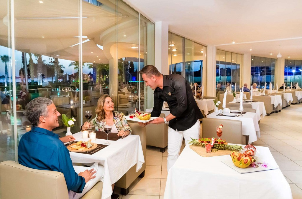Couple being served a delicious meal in the resort