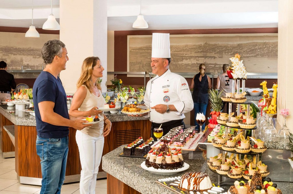Guests enjoying the great variety of dishes offered at the buffet at Kusadasi Golf & Spa resort