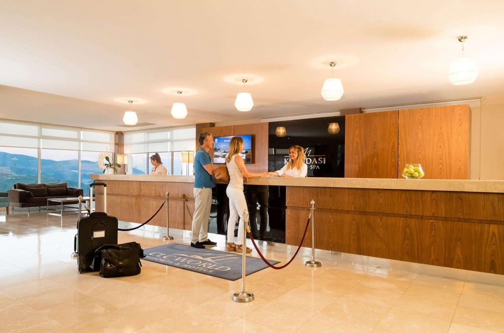 Guests checking in at reception at Kusadasi Golf & Spa