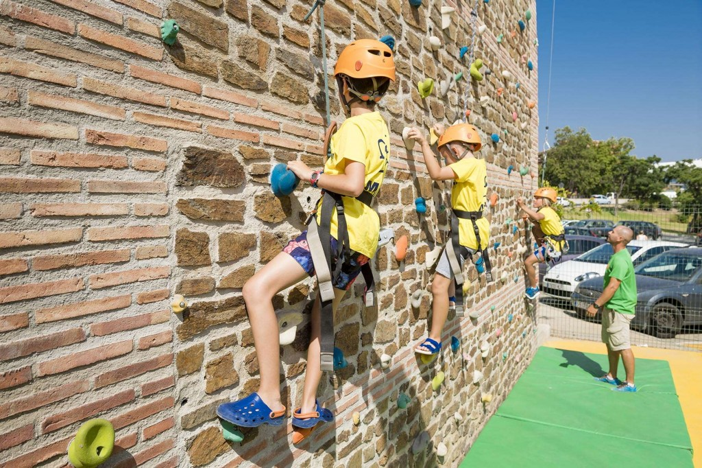 Younger guests rock climbing