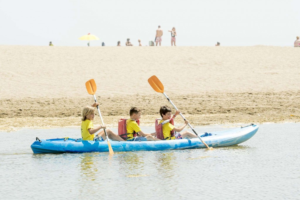 Younger guests kayaking along the river on the Costa del Sol at Fuengirola