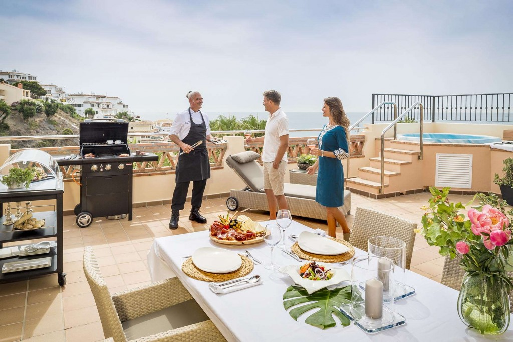 Guests enjoying a barbecue in their Santa Cruz Signature Suites terrace