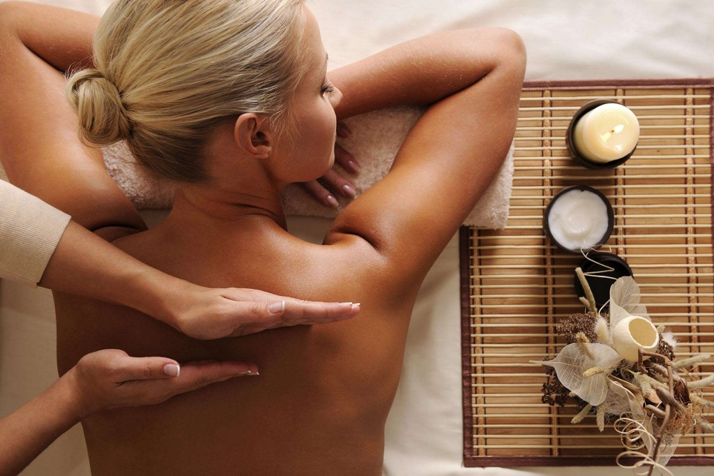 A guest enjoying one of the massages offered at Santa Cruz Signature Suites