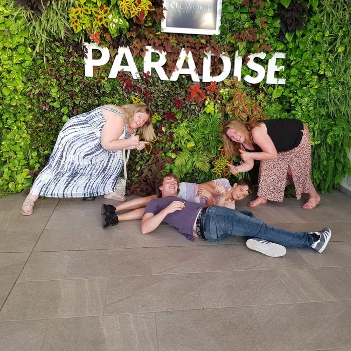 Guests in front of Paradise flower wall