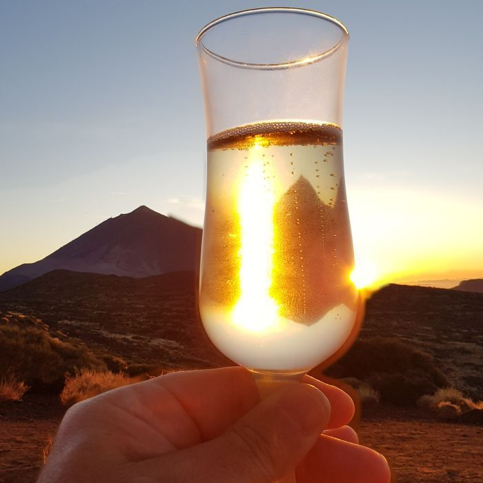 Champagne glasses in front of Teide at sunset